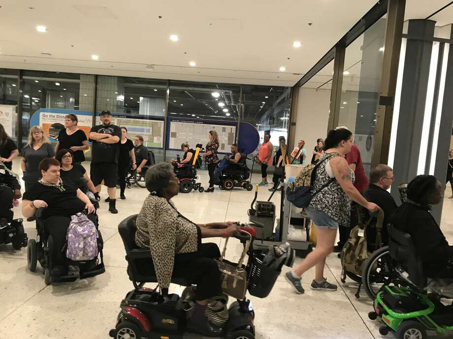 """Advocatesand individuals with disabilities hold a silent """"funeral"""" for the state's Consumer Directed Personal Assistance Program in August 2019, ahead of proposed cuts to the popular home care program. (Provided by Barbara Crosier) Photo: Provided By Barbara Crosier"""