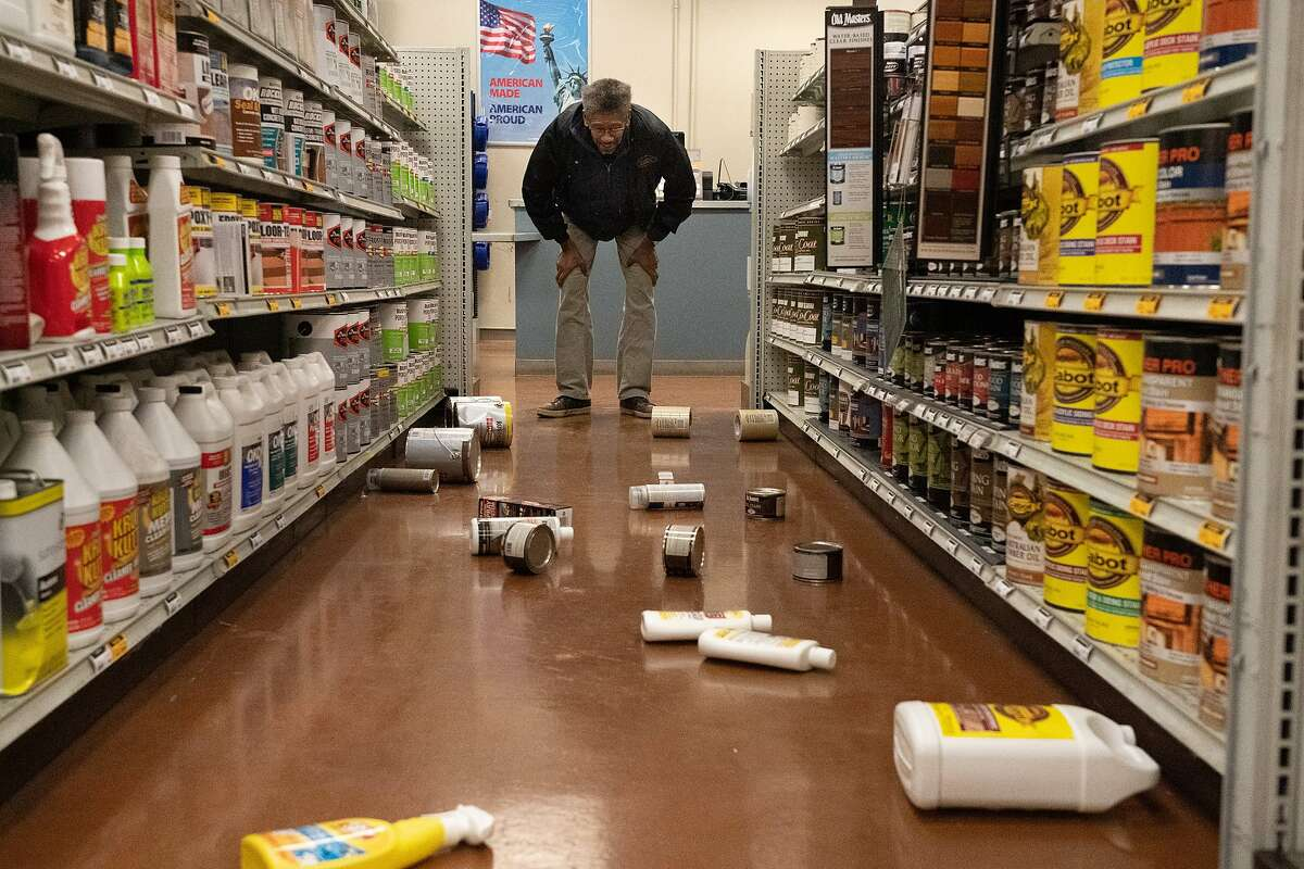Barry Craig, looks at fallen paint cans at Dunn-Edwards Paints on Tuesday, Oct. 15, 2019, in Pleasant Hill, Calif.