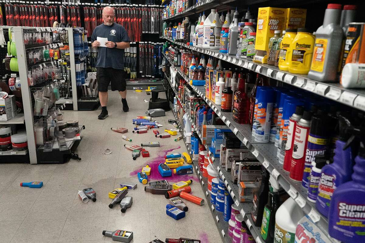 Brian Maloney, warehouse manager at Monument Car Parts looks at fallen merchandise on Tuesday, Oct. 15, 2019, in Pleasant Hill, Calif.