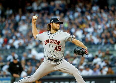 Houston Astros starting pitcher Gerrit Cole (45) pitches during the bottom of the second inning of Game 3 of the American League Championship Series at Yankee Stadium in New York on Tuesday, Oct. 15, 2019.