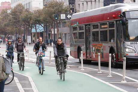 Bicyclists ride along Market Street east of 10th Street on Tuesday, October 15, 2019 in San Francisco, Calif. Photo: Lea Suzuki / The Chronicle