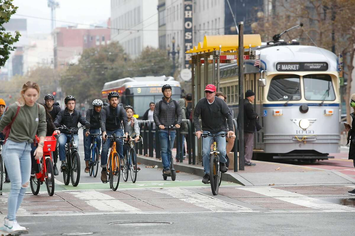 Bicyclists ride along Market Street east of 10th Street on Tuesday, October 15, 2019 in San Francisco, Calif.