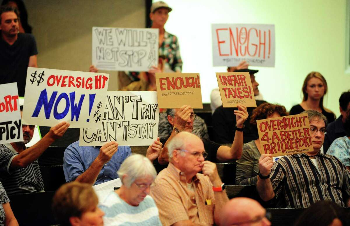 About two dozen members and supporters of Citizens Working for a Better Bridgeport spearheaded a protest to bring awareness to increased taxes and other issues like safety, schools, and jobs during the public comment portion of the Bridgeport City Council meeting at City Hall in Bridgeport, Conn., on Tuesday Sept. 6, 2016.