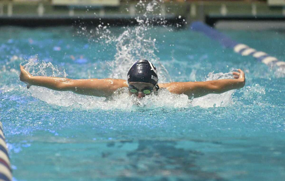Wilton's Emma Babashak swims in the 100-yard butterfly during the State Open last season.