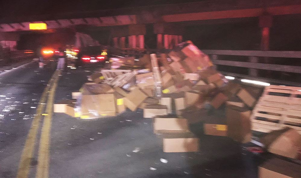 Tractor-trailer slams into train trestle near Lacey, spills load of chocolate-coated pretzels