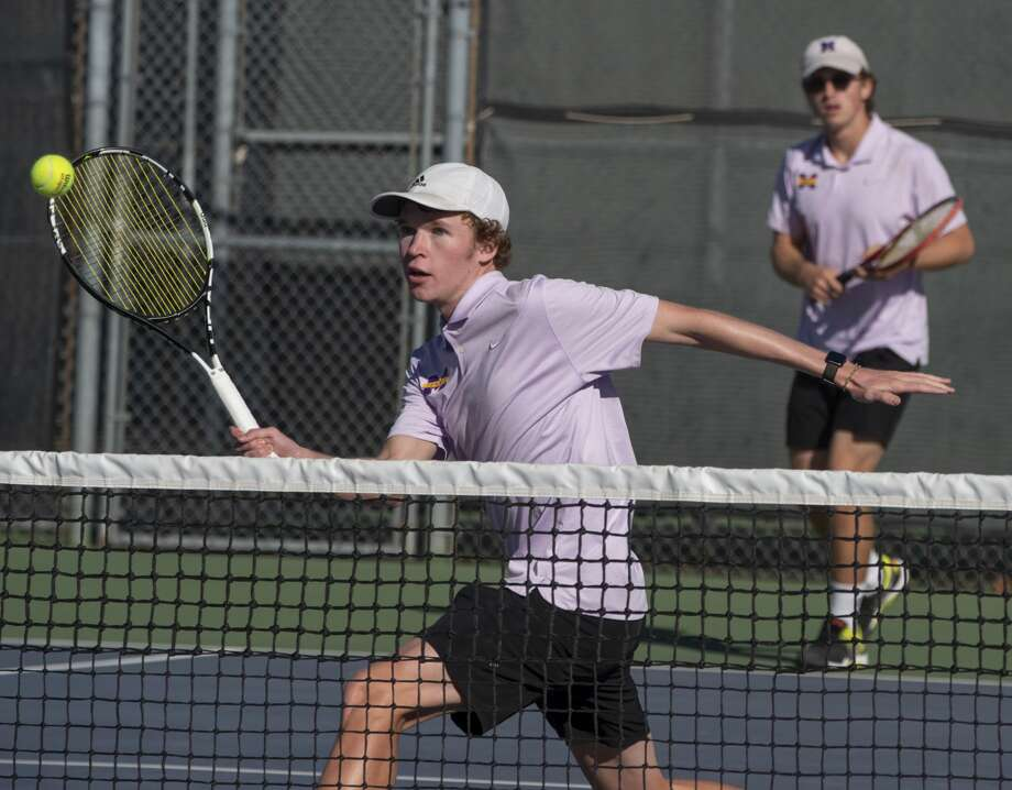 Sean Daugherty returns a shot as doubles partner Nathan Boles waits 10/15/19 as MHS takes on El Paso Americas in the 6A bi-district playoff at Midland High tennis courts. Tim Fischer/Reporter-Telegram Photo: Tim Fischer/Midland Reporter-Telegram