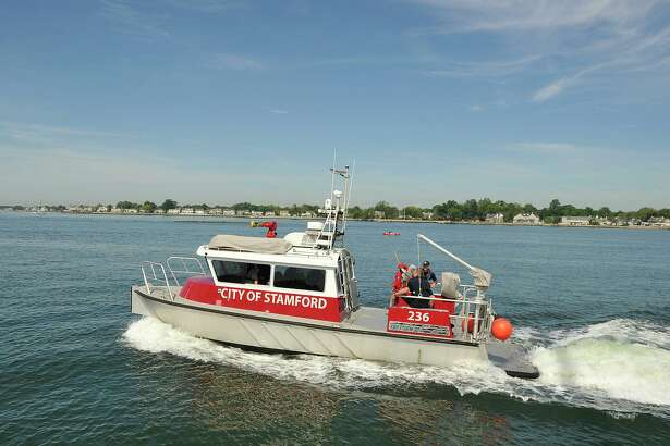 The Stamford Fire Department's fire boat leaves Stamford Harbor on Sunday, June 8, 2014.