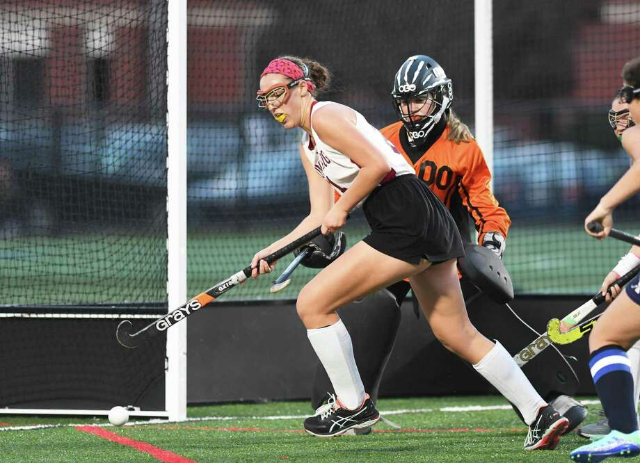 Pomeraug's Allison McCormick keeps her eye on the ball in front of Immaculate goalie Lauren Oskam during the SWC Field Hockey Championship game between Pomperaug and Immaculate at New Milford High in New Milford, 11/2/17. Photo: Krista Benson / The News-Times Freelance