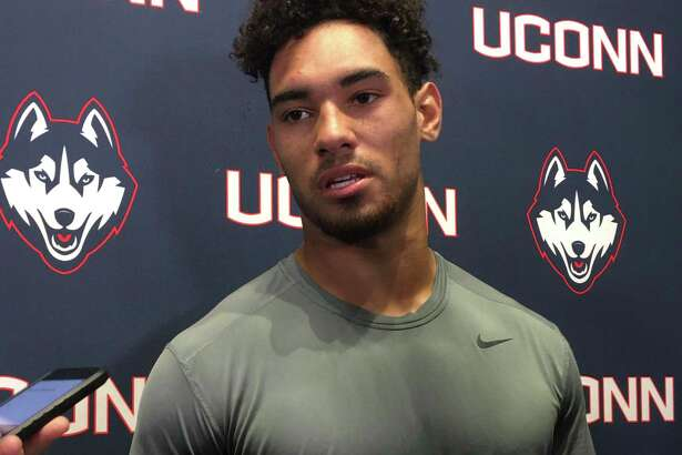 UConn linebacker Jackson Mitchell answers questions from reporters Tuesday. Mitchell, a freshman, will start Saturday against Houston.