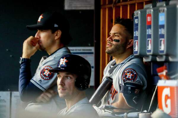 Houston Astros third baseman Alex Bregman (2) and Houston Astros second baseman Jose Altuve (27) sit in the dugout during a long delay to replace home-plate umpire Jeff Nelson who had to leave the game after being hit in the mask by a foul tip during the fourth inning of Game 3 of the American League Championship Series at Yankee Stadium in New York on Tuesday, Oct. 15, 2019.