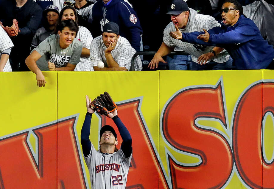 Yankees fans scream from right field as Houston Astros right fielder Josh Reddick (22) fields a long fly ball from New York Yankees shortstop Didi Gregorius (18) to end the bottom of the fifth inning of Game 3 of the American League Championship Series at Yankee Stadium in New York on Tuesday, Oct. 15, 2019. See more photos from ALCS Game 2 >>> Photo: Brett Coomer, Staff Photographer / © 2019 Houston Chronicle