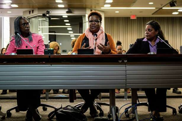 Susan Peterkin-Bishop, center, owner of Jaha hair salon, speaks during the public hearing on CROWN Act at Montgomery County Council Office Building on Tuesday, Oct. 15, 2019, in Rockville, Maryland.