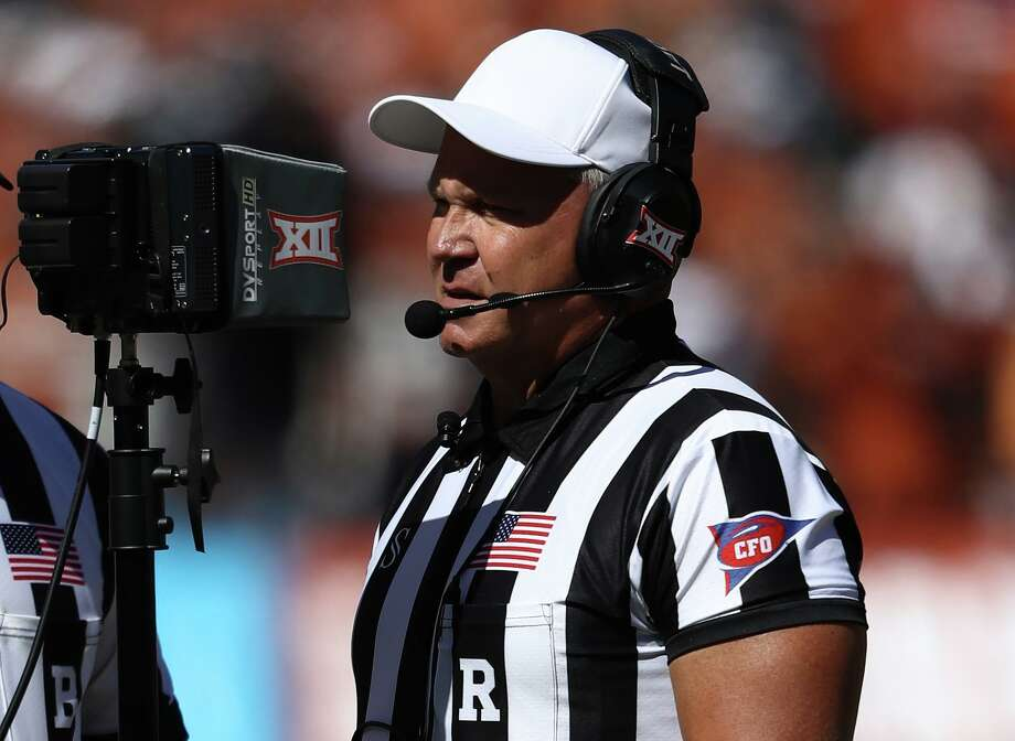 DALLAS, TEXAS - OCTOBER 12: Referee Mike Defee reviews a play between the Oklahoma Sooners and the Texas Longhorns during the 2019 AT&T Red River Showdown at Cotton Bowl on October 12, 2019 in Dallas, Texas. (Photo by Ronald Martinez/Getty Images) Photo: Ronald Martinez, Staff / Getty Images / 2019 Getty Images