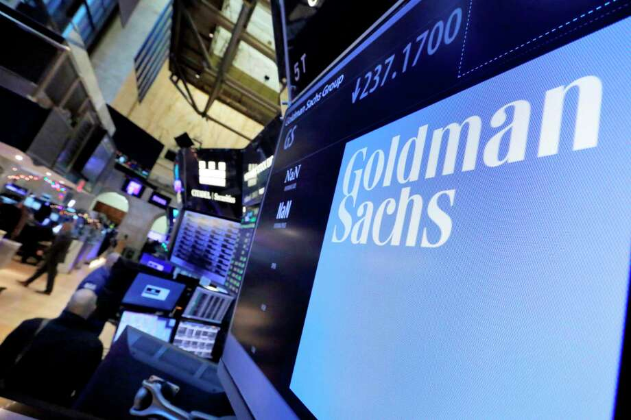 FILE - In this Dec. 13, 2016, file photo, the logo for Goldman Sachs appears above a trading post on the floor of the New York Stock Exchange. The Goldman Sachs Group Inc. reports financial results Tuesday, Oct. 14, 2019. (AP Photo/Richard Drew, File) Photo: Richard Drew / Copyright 2019 The Associated Press. All rights reserved.
