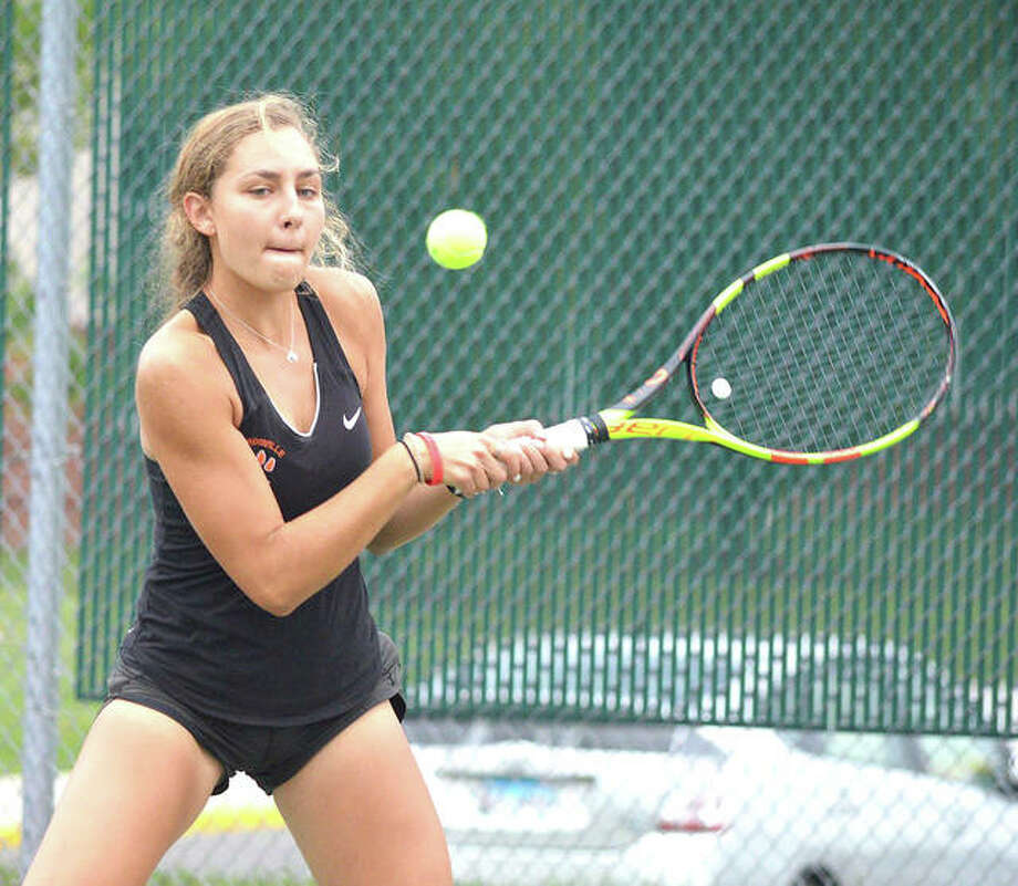 Edwardsville senior Hayley Earnhart makes a backhand return during her No. 3 doubles match on Tuesday in the Southwestern Conference Tournament at the EHS Tennis Center. Photo: Scott Marion/The Intelligencer