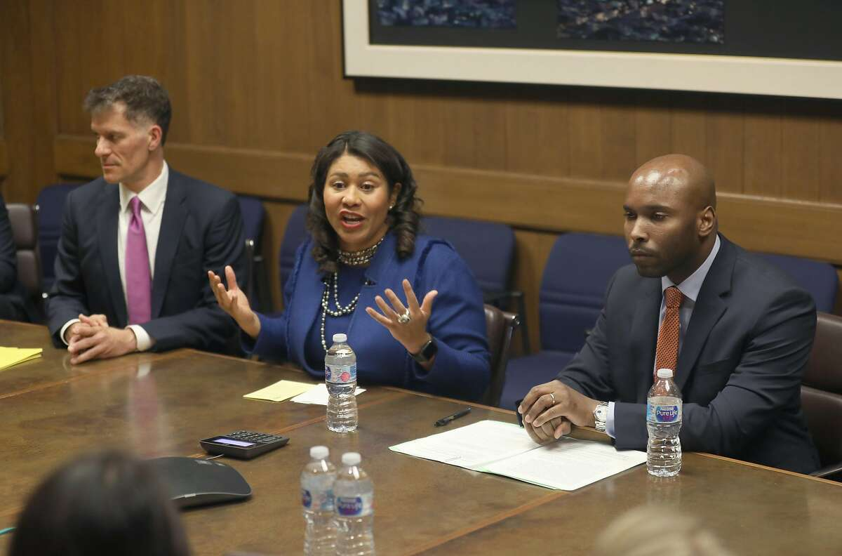 Dr. Grant Colfax (left), director of health, Mayor London Breed (middle) and Dr. Anton Nigusse Bland (right), director of Mental Health Reform make an announcement about homelessness at the San Francisco Chronicle on Tuesday, Oct. 15, 2019, in San Francisco, Calif.