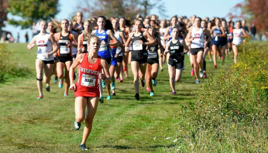 Greenwich's Mari Noble leads competitors at the start of the FCIAC girls Cross Country championship meet at Waveny Park in New Canaan on Tuesday. Noble went on to win the race, placing first with a personal best-time of 14:06. Photo: Matthew Brown / Hearst Connecticut Media / Stamford Advocate