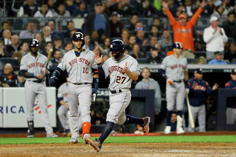 Houston Astros' Jose Altuve celebrates after scoring on a wild pitch during the seventh inning in Game 3 of baseball's American League Championship Series against the New York Yankees Tuesday in New York. Photo: Matt Slocum, STF / Associated Press / Copyright 2019 The Associated Press. All rights reserved