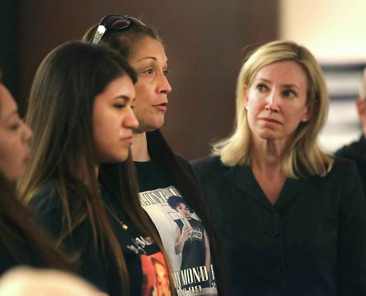 Valerie Silva, center, mother of murder victim Raymond Silva, and Lorraine Silva, left, his sister, speak directly to David Samora who plead no contest to murdering Silva, after the trial had started in the 187th State District Court in the Cadena-Reeves Justice Center, on Tuesday, Oct. 15, 2019. At right is state procecutor Tamara Strauch.