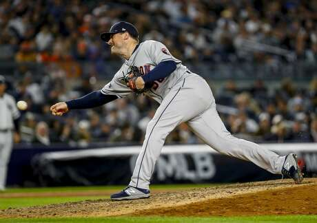 Houston Astros relief pitcher Joe Smith (38) pitches during the bottom of the eighth inning of Game 3 of the American League Championship Series at Yankee Stadium in New York on Tuesday, Oct. 15, 2019.