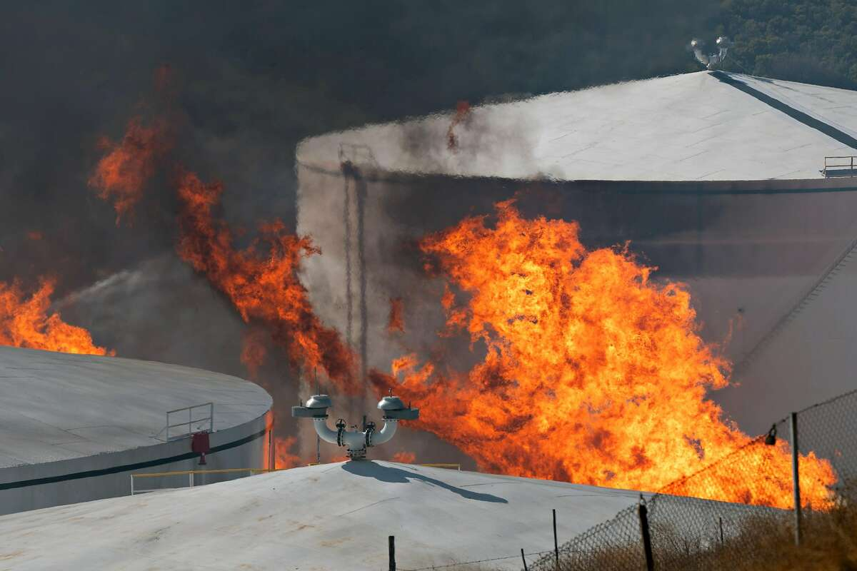 Flames engulf the NuStar energy facility after reports of an explosion in Crockett, Calif. on Tuesday, Oct. 15, 2019.
