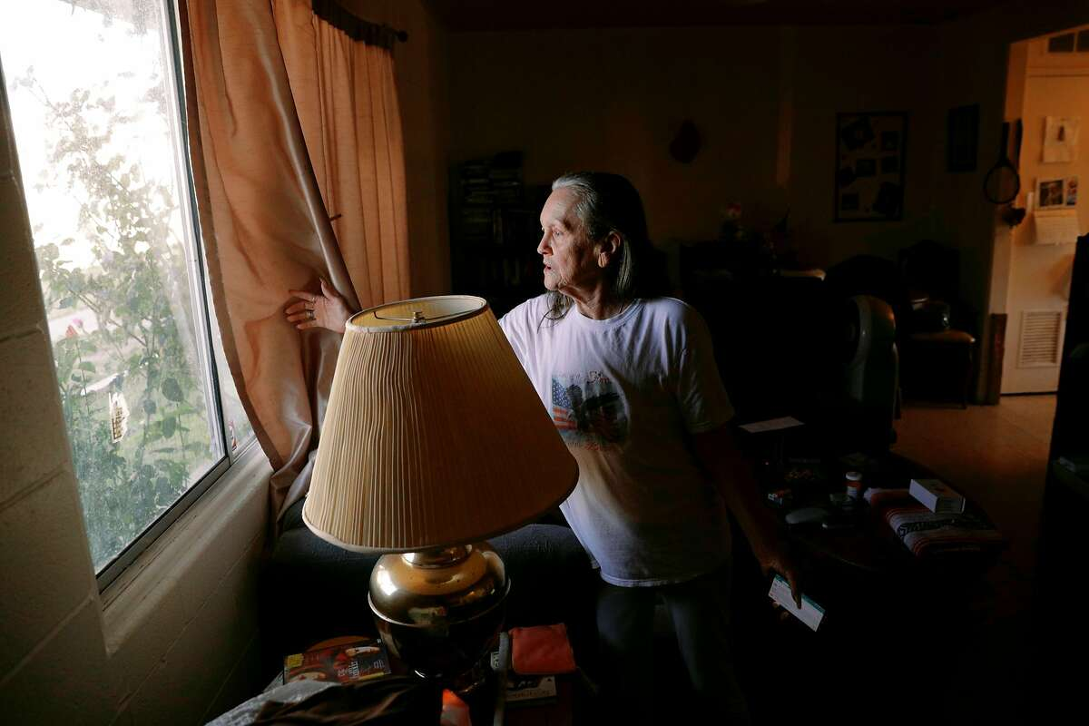 Kathy Reed of Tulibee Court in Rodeo stand inside her living room where she is sheltered in place place for several hours after an explosion and fire at the new star energy facility in Crocket calif., on Tuesday, October 15, 2019