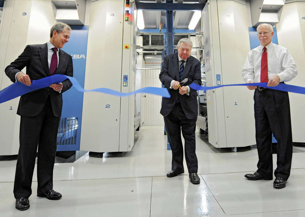 From left, Steven R. Swartz, president and chief operating officer of Hearst Corporation; Frank A. Bennack, Jr., chief executive officer of Hearst Corporation; and George R. Hearst III, Times Union publisher and CEO take part in the official ribbon cutting ceremony for the new press at the Times Union on Thursday, March 14, 2013 in Colonie, N.Y. (Lori Van Buren / Times Union)