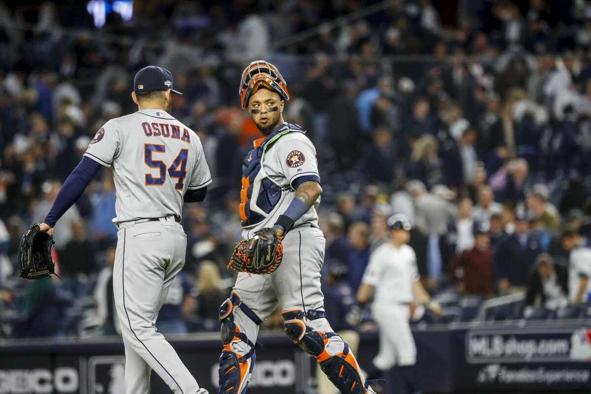 Houston Astros relief pitcher Roberto Osuna (54) and Houston Astros catcher Martin Maldonado (12) walk off the mound at the end of the ninth inning of Game 3 of the American League Championship Series at Yankee Stadium in New York on Tuesday, Oct. 15, 2019.