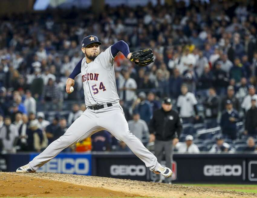Houston Astros relief pitcher Roberto Osuna (54) pitches during the ninth inning of Game 3 of the American League Championship Series at Yankee Stadium in New York on Tuesday, Oct. 15, 2019.