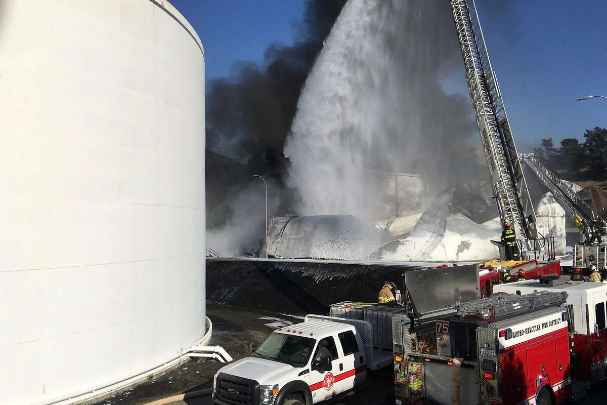 Firefighters from Vallejo Fire Dept, Rodeo-Hercules Fire Dept and Contra Costa County Fire Dept attempt to extinguish the fire at the NuStar energy facility after reports of an explosion in Crockett, Calif. on Tuesday, Oct. 15, 2019.