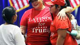 Jen Salinas hugs pulls her daughter into a conversation with Martha Doss as the trio wear Latinos for Trump shirts while Donald Trump, Jr. visits the Henry B. Gonzalez Convention Center on behalf of the Trump/Pence 2020 rel-election campaign on Oct. 15, 2019.