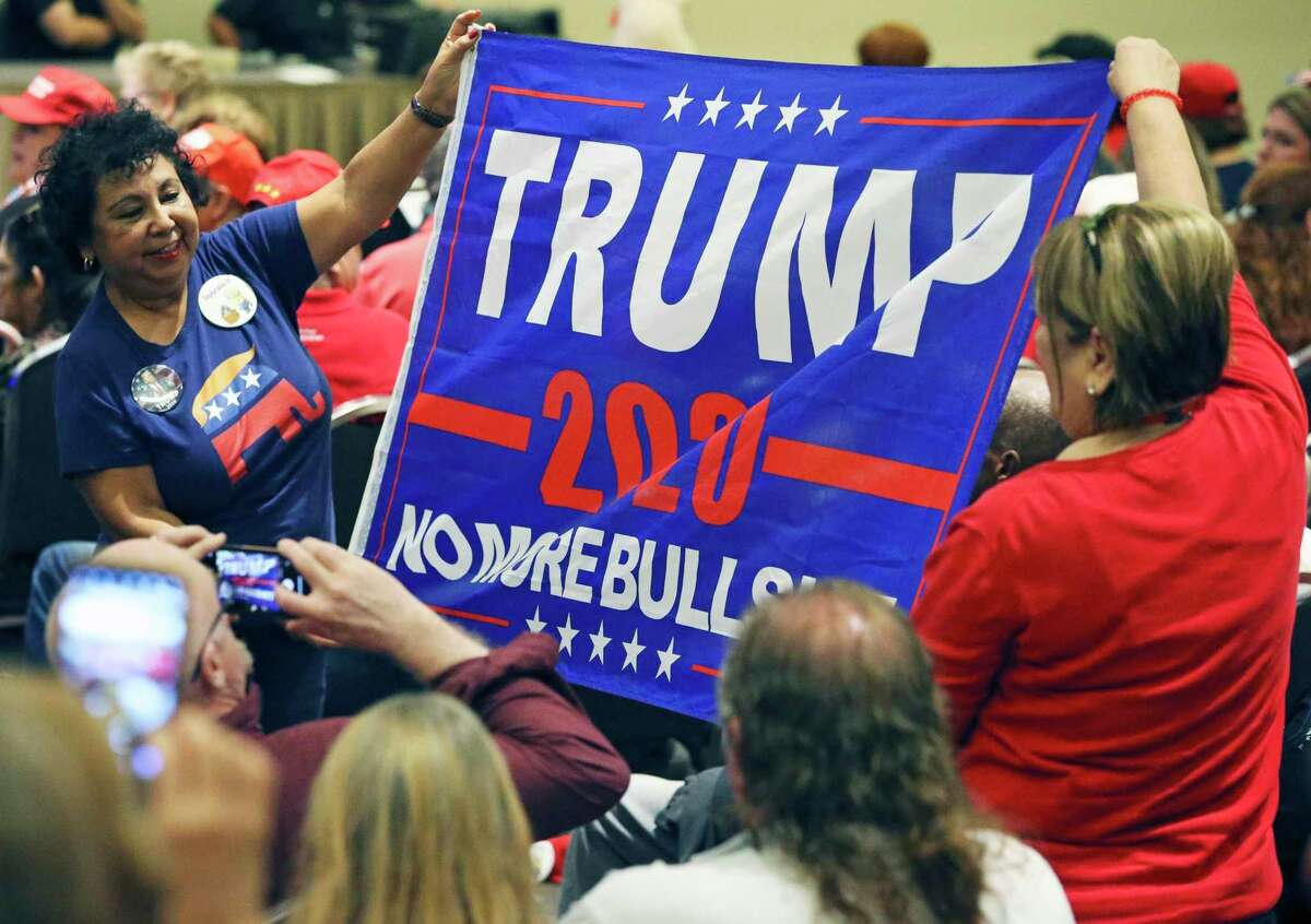 Eva Mickler,left, and Esther Brant parade a banner as Donald Trump, Jr. visits the Henry B. Gonzalez Convention Center on behalf of the Trump/Pence 2020 rel-election campaign on Oct. 15, 2019.