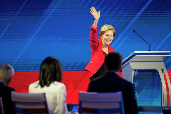 Democratic presidential candidate Sen. Elizabeth Warren, D-Mass., is welcomed to the stage during the Democratic presidential debate inside Texas Southern University's Health & PE Arena in Houston, Thursday, Sept. 12, 2019.