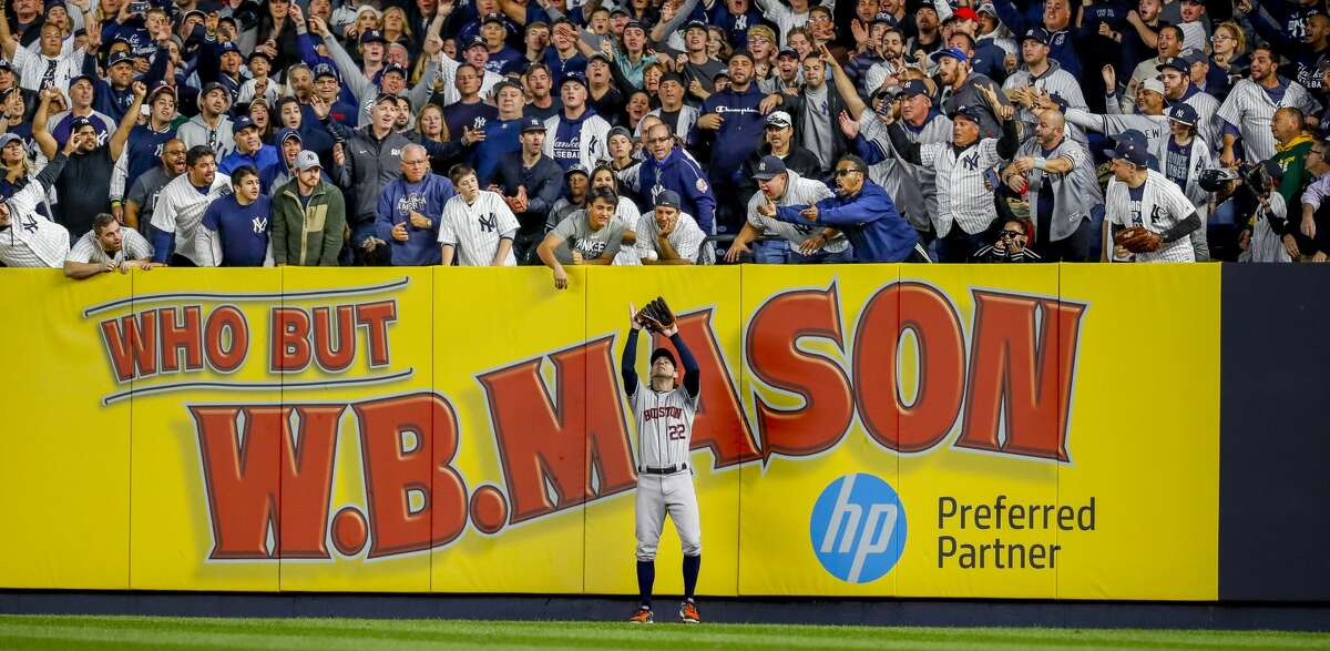 Yankees fans scream from right field as Houston Astros right fielder Josh Reddick (22) fields a long fly ball from New York Yankees shortstop Didi Gregorius (18) to end the bottom of the fifth inning of Game 3 of the American League Championship Series at Yankee Stadium in New York on Tuesday, Oct. 15, 2019.