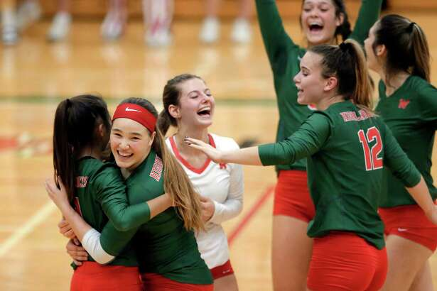 The Woodlands players celebrate winning their first match against Klein during their 6A district match at The Woodlands High School Tuesday, Oct. 15, 2019 in The Woodlands, TX.
