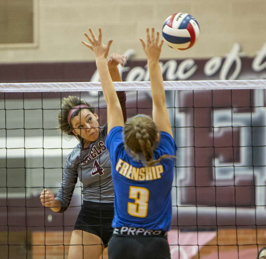 Lee's McKenzie Gibson (4) hits the ball off Frenship's Devyn Narin's (3) hands on Tuesday, Oct. 15, 2019 at Lee High School.  J Photo: Jacy Lewis/Reporter-Telegram