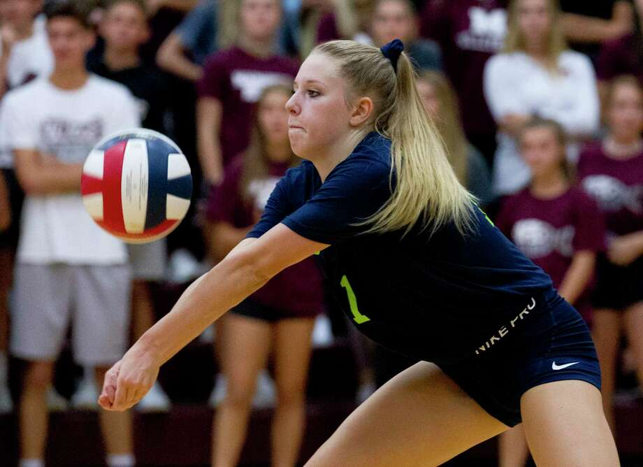 College Park outside hitter Mallory Madison, shown here in August against Magnolia, had 10 kills Tuesday versus Oak Ridge as the Lady Cavaliers clinche a playoff spot in District 15-6A. Photo: Jason Fochtman, Houston Chronicle / Staff Photographer / Houston Chronicle