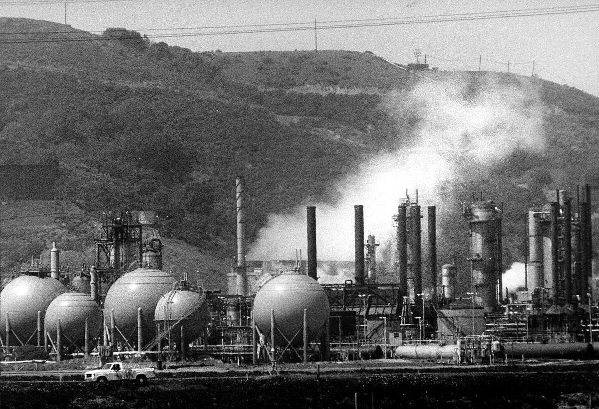 The site of the Chevron fire Tuesday morning. The white smoke is what remains from Monday's fire. The round containers hold liquid propane gas. April 11, 1989.