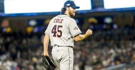 Houston Astros starting pitcher Gerrit Cole (45) reacts while pitching during the sixth inning of Game 3 of the American League Championship Series at Yankee Stadium in New York on Tuesday, Oct. 15, 2019.