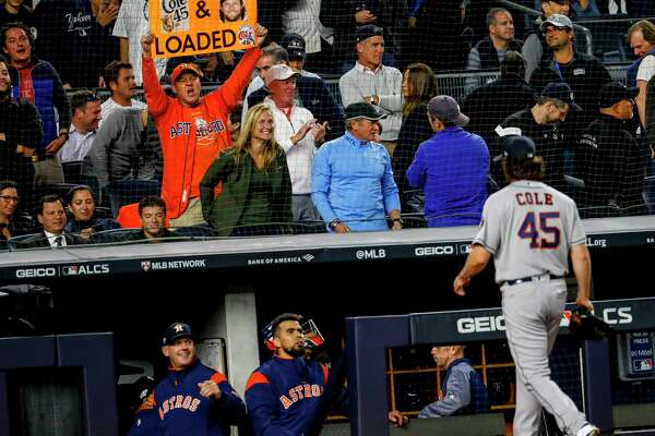 An Astros fan holds up a sign as Houston Astros starting pitcher Gerrit Cole (45) walks back to the dugout at the end of the fifth inning of Game 3 of the American League Championship Series at Yankee Stadium in New York on Tuesday, Oct. 15, 2019.