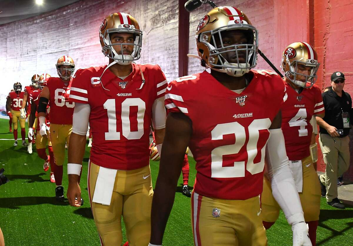 LOS ANGELES, CA - OCTOBER 13: Quarterback Jimmy Garoppolo #10 and cornerback Jimmie Ward #20 of the San Francisco 49ers take the field for the game against the Los Angeles Rams at Los Angeles Memorial Coliseum on October 13, 2019 in Los Angeles, California. (Photo by Jayne Kamin-Oncea/Getty Images)