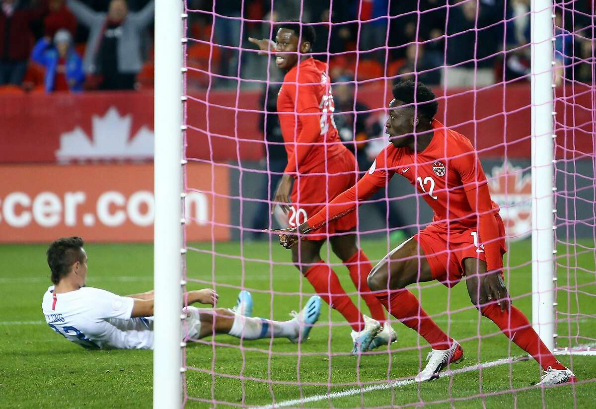 Alphonso Davies #12 of Canada celebrates a goal during a CONCACAF Nations League game against the United States at BMO Field on October 15, 2019 in Toronto, Canada.