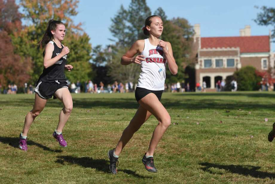 New Canaan's Molly Murphy runs along the 4,000-meter course during the FCIAC girls cross country championship race in Waveny Park on Tuesday, Oct. 15, 2019. Photo: Dave Stewart / Hearst Connecticut Media / Hearst Connecticut Media