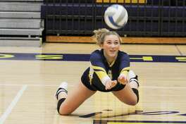 Manistee's Logan Wayward makes a diving dig during the Chippewas' match against Orchard View on Tuesday.