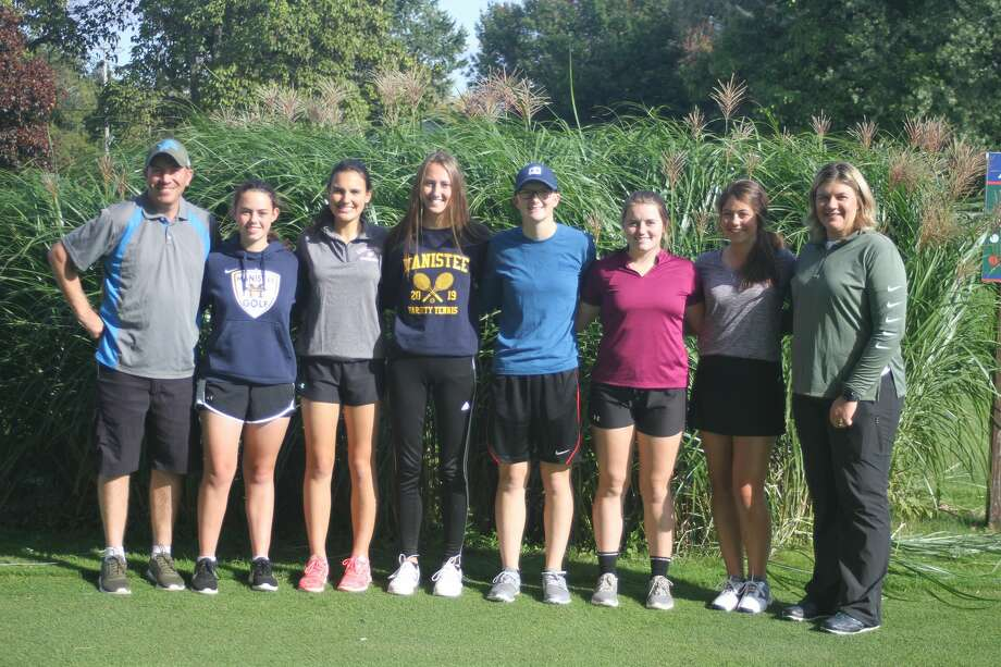 The Manistee girls golf team will compete in the Division 4 state finals on Friday and Saturday. Pictured (from left to right) are assistant coach Chad Murray, Amy Bagley, Marial Rahn, Ari Kamaloski, Trista Arnold, Lily Sandstedt, Sara Thompson and head coach Bridget Warnke. (News Advocate) Photo: Dylan Savela/News Advocate