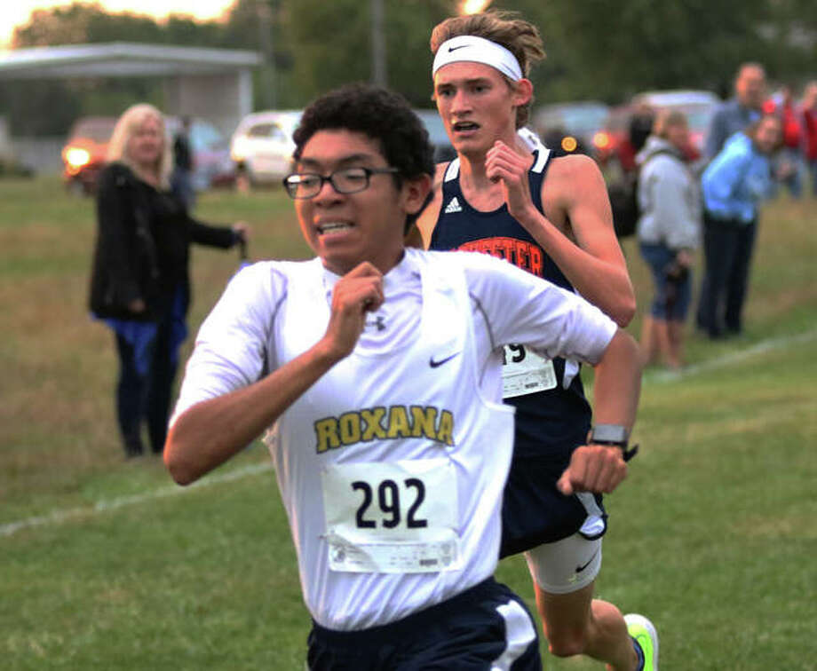 Roxana's Carlos Ruvalcaba (front) holds off a late surge from Rochester's Matt Herren to win the Carlinville Invitational cross country meet's boys race on Tuesday at the Macoupin County Fairgrounds in Carlinville. Photo: Greg Shashack / The Telegraph