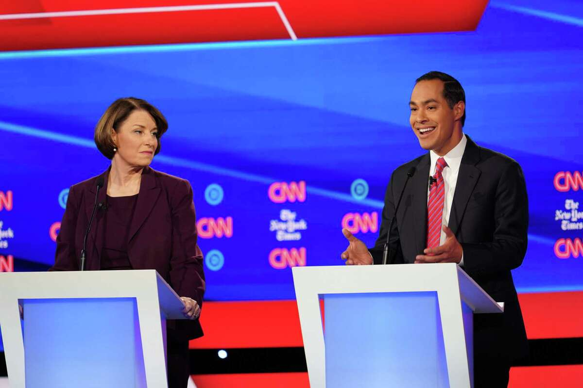 Former Housing Secretary Julian Castro, right, speaks during the Democratic presidential debate at Otterbein University in Westerville, Ohio, on Tuesday, Oct. 15, 2019. Sen. Amy Klobuchar (D-Minn.) is at left. (Tamir Kalifa/The New York Times)
