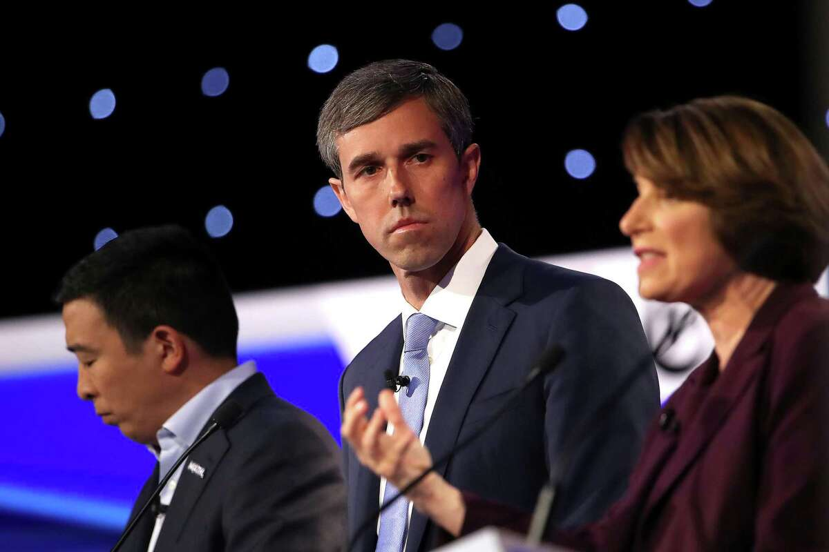 WESTERVILLE, OHIO - OCTOBER 15: Former Texas congressman Beto O'Rourke and former tech executive Andrew Yang look on as Sen. Amy Klobuchar (D-MN) speaks during the Democratic Presidential Debate at Otterbein University on October 15, 2019 in Westerville, Ohio. A record 12 presidential hopefuls are participating in the debate hosted by CNN and The New York Times. (Photo by Win McNamee/Getty Images)
