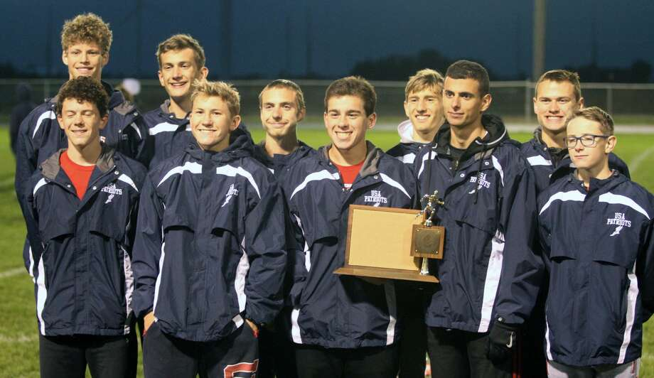 The USA boys cross country team won the Greater Thumb Conference West title on Tuesday. Photo: Eric Rutter/Huron Daily Tribune