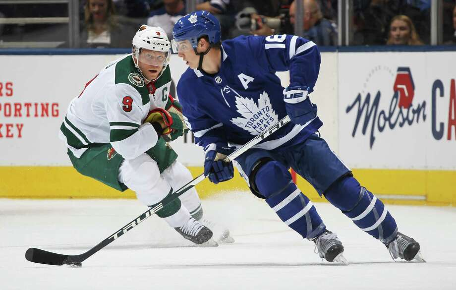 TORONTO, ON - OCTOBER 15:  Mitchell Marner #16 of the Toronto Maple Leafs carries the puck as Mikko Koivu #9 of the Minnesota Wild pursues during an NHL game at Scotiabank Arena on October 15, 2019 in Toronto, Ontario, Canada. (Photo by Claus Andersen/Getty Images) Photo: Claus Andersen / 2019 Getty Images